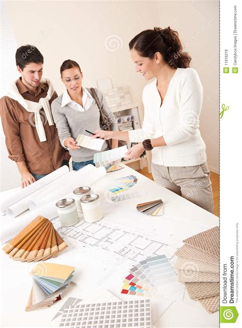 Successful Interior Designer Woman With Two Client Stock