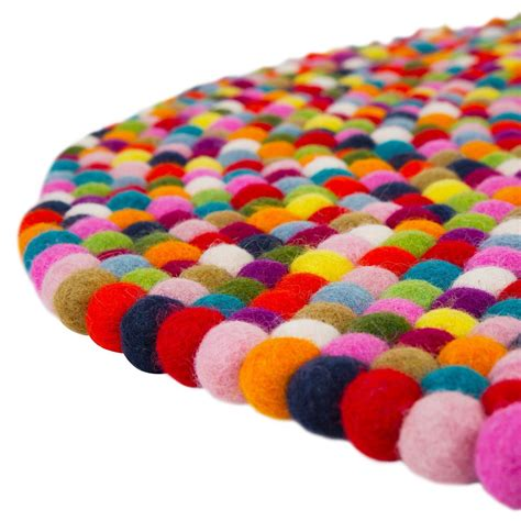 multi coloured pom pom rug