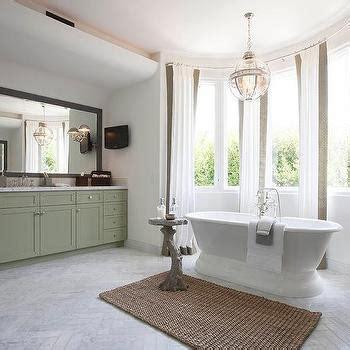 gray  gold bathroom  taupe herringbone tiles