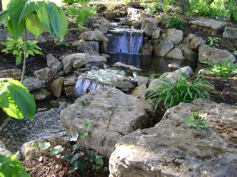 koi pond with waterfall weilbacher landscaping retaining walls paver