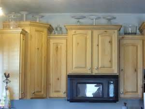 decorating above kitchen cabinets ideas 5 ideas for decorating above kitchen cabinets