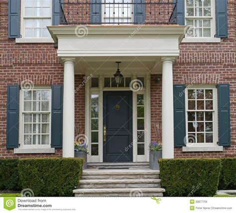 Cape Style Home Decorated Classic Color And Pattern by Portico Designs For Front Door For The Home In 2019