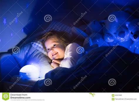 Little Girl Reading A Book In Bed Stock Image Image