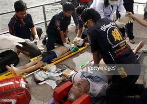 Thai rescue personnel administer first aid and perform CPR ...