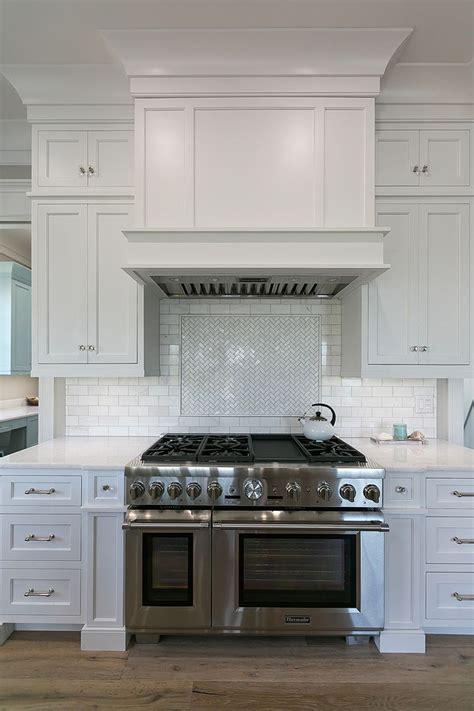 custom range hood in white kitchen   Mahshie Custom Homes