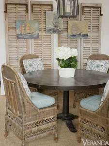 Antique shutters as wall decor layered with art applepins