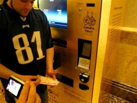 buying gold   vending machine  abu dhabi  emirates