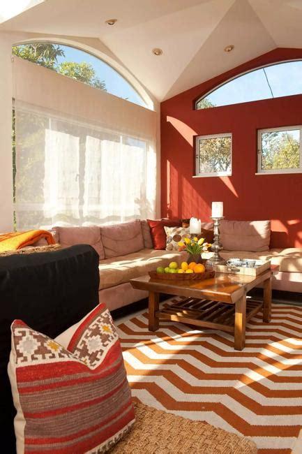 terracotta sofa living room pumpkin color palette warm hues and fall decorating ideas