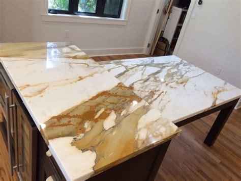 kitchen island with barstools brown quartz kitchen tops calacatta gold marble island