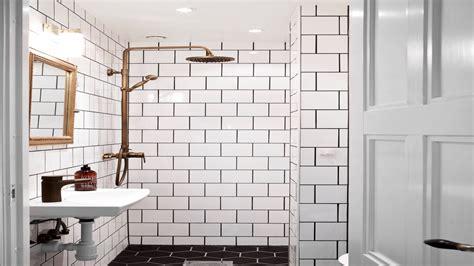 bathroom white square tiles black grout brass details ideas