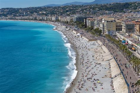 People Sunbathing On The Beach In Nice France Editorial