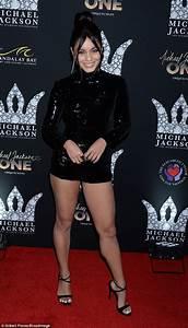 Vanessa Hudgens Shows Off Her Legs In Figure Hugging Black