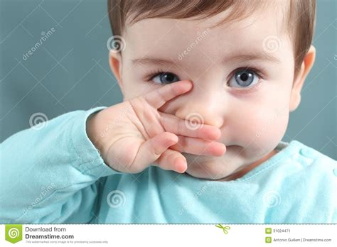 Close Up Of A Baby Girl Looking At Camera With A Big Blue