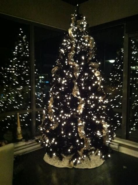 black tree with lights 25 best ideas about black christmas trees on pinterest red black white christmas classic