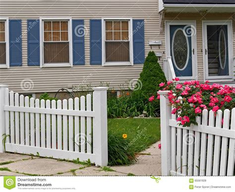 Front Yard With White Picket Fence Stock Photo