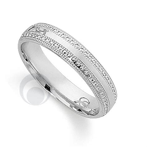 pretty patterened platinum wedding ring wedding from the platinum ring company hitched co uk