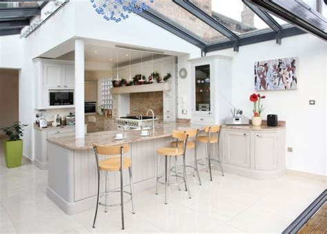 Open and bright contemporary kitchen extension with bar