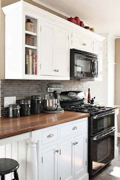 lights in the kitchen grey cabinets black appliances silver hardware 7076