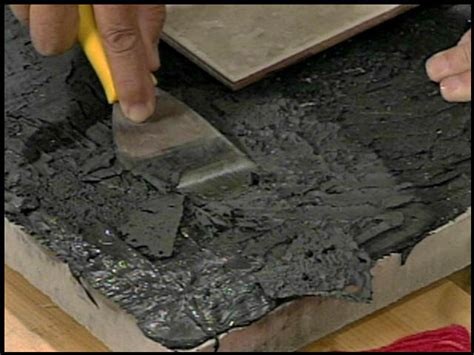 remove carpet adhesive