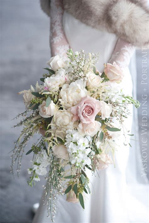 Exquisite Cascading Ivory And Pale Pink Winter Wedding