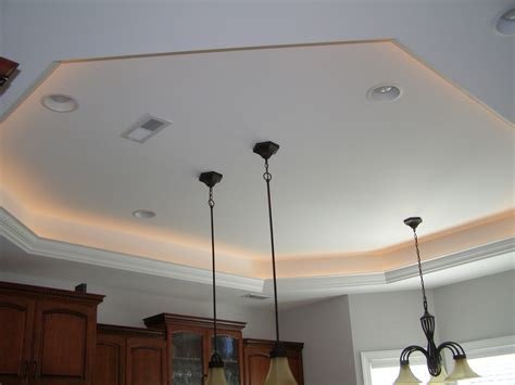 tray ceiling lights reflect the surface for the