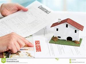 Hands reviewing real estate property documents royalty for Property documents images