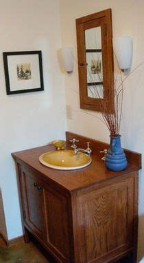 hand  white oak stained bathroom vanity closed style
