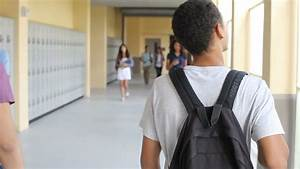 Group Of High School Students Walking Along Hallway Stock ...
