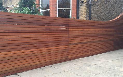 horizontal cedar hardwood strip wood trellis screen fence