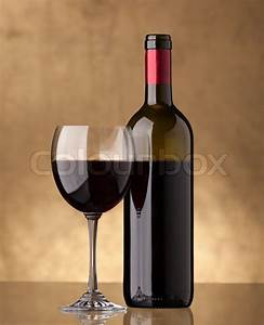 A bottle of red wine and filled a wine glass | Stock Photo ...