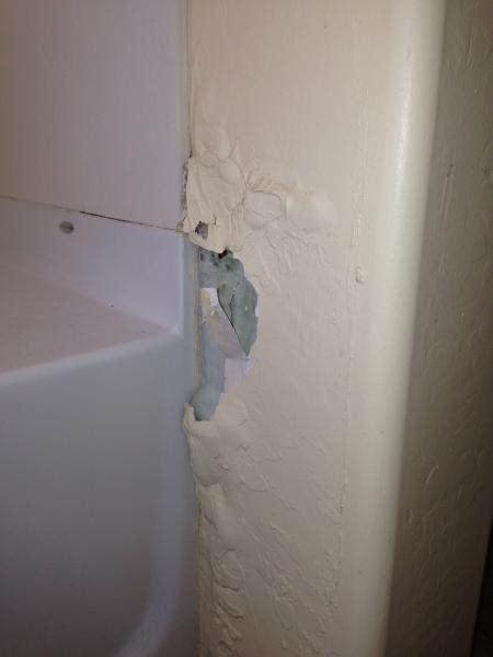 repairing damaged drywall section adjacent  shower