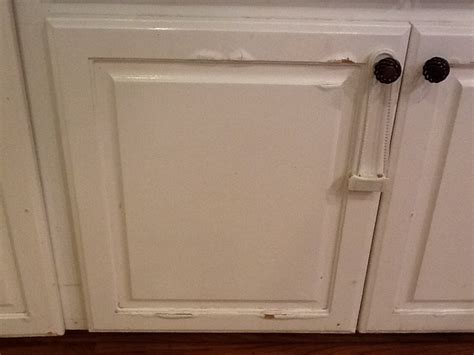 damaged kitchen cabinets hometalk water damage on press wood kitchen cabinets 3081