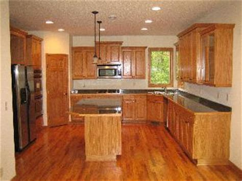 kitchen remodel keeping old cabinets kitchen remodel with oak cabinetry pictures and photos
