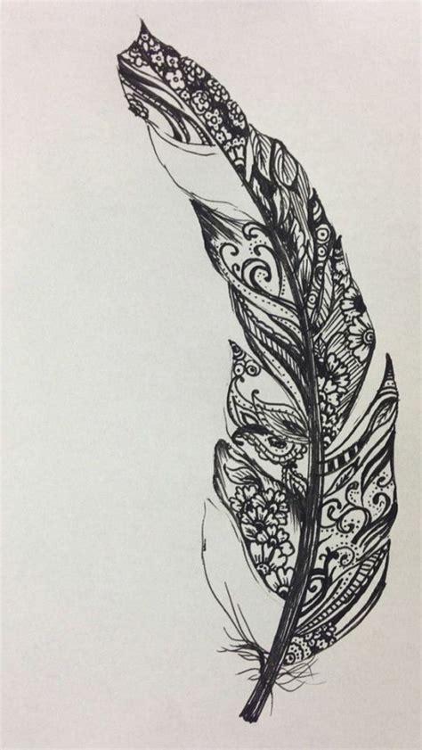 tatouage ecriture avec plume