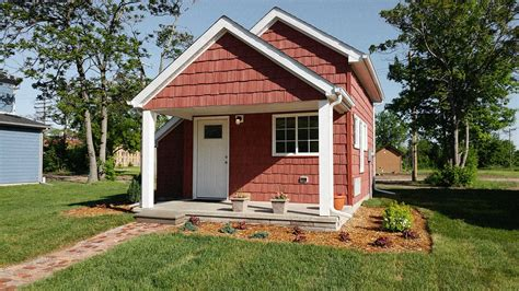 two houses these tiny houses help minimum wage workers become home