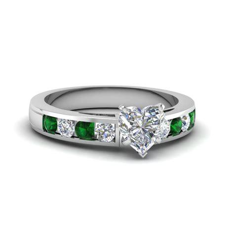 Stunning Emerald Side Stone Engagement Rings  Fascinating. Women's Rings. Title Screen Rings. Joker Harley Wedding Rings. Tiny Engagement Rings. Unique Square Engagement Wedding Rings. Pink Tourmaline Rings. Heart Wedding Rings. Lion Symbol Rings