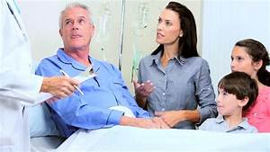 Hospital Doctor Taking Blood Pressure Of Senior Male ...