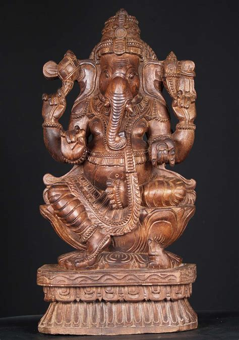 sold wooden ganesh carving holding tusk  whl