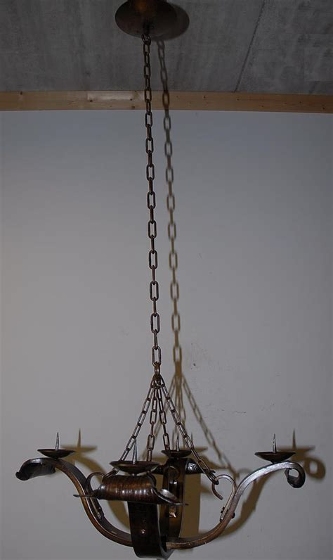 a vintage wrought iron candle burning chandelier from