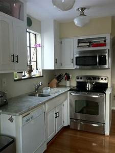 White solid wood small kitchen cabinet using grey marble for Kitchen cabinet trends 2018 combined with painted metal art wall hanging
