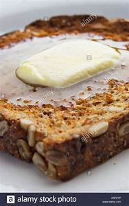 Slice of whole wheat bread toasted with melting butter ...