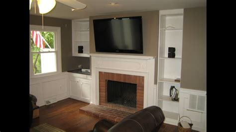 tv above fireplace where to put components mounting tv above fireplace