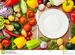 Fresh Organic Vegetables Around White Plate With Knife And