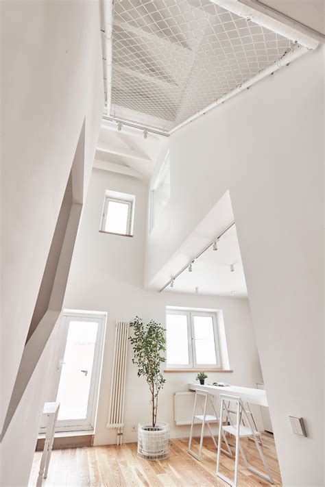 A White And Wood House For A Stylish Family by A White And Wood House For A Stylish Family