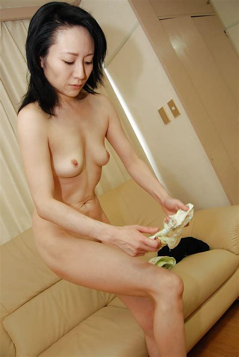 Slender Asian Milf Taking Shower And Rubbing Her Soapy