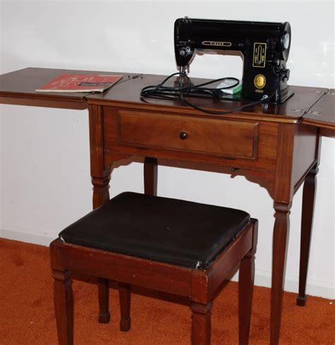vintage singer sewing machine in cabinet ebth