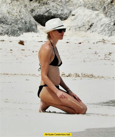 Naomi Watts caught in black bikini on the beach in Barbados
