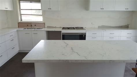 white kitchen with island miele honed marble kitchen benchtop