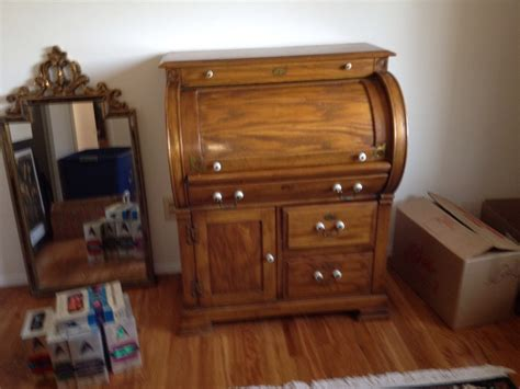 i have an antique roll top writing desk that has a