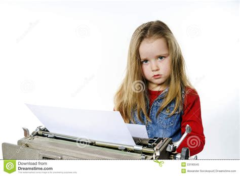 Cute Little Girl Typing Vintage Typewriter Keyboard Stock